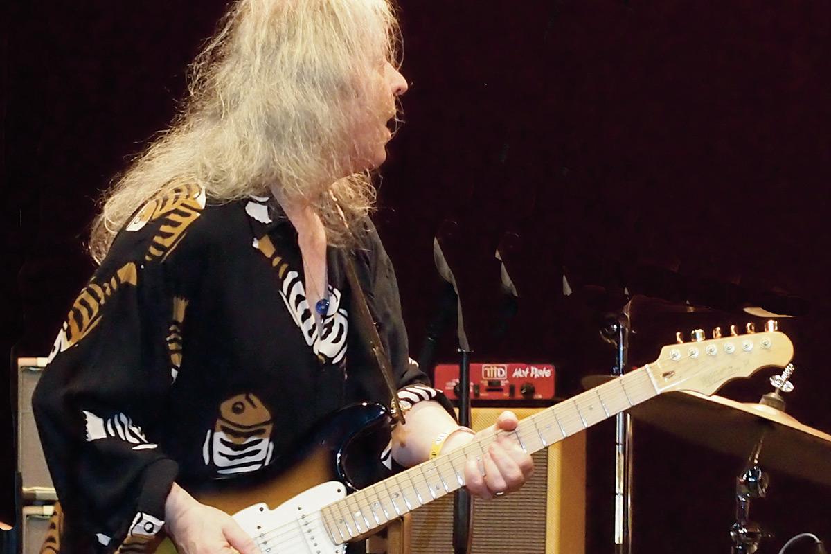 John Verity playing guitar