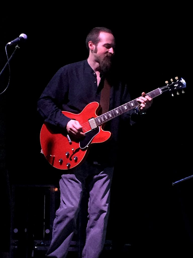 Jules Fothergill playing guitar with Northsyde