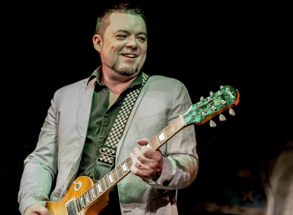 Sean Webster playing guitar